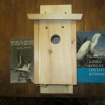 Item #1 Blue Bird House with two bird books, donated by Phil Webster, valued at $55, opening bid $30