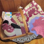 "Item # 9 ""Welcome Baby Girl"" (pink & white baby afghan, Minnie Mouse hat, socks, & washcloths), donated by Ardyce Bresett, valued at $80, opening bid $40"