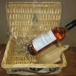 20) wine basket (wine, 2 wine glasses, cheese board & knife, cheese) valued at $40, starting bid $20