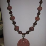 "56) ""Marisa"" Carved carnelian; poppy jasper; silver base beads handmade valued at $46, starting bid $25"