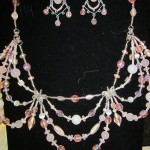"57) ""Katarina"" handmade pendant with earrings valued at $136, starting bid $70"